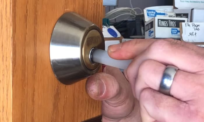 how to get a broken key out of a lock with hot glue